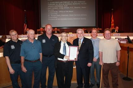 Members of Floyd Holmes Sine's family join members of the Water Services Department at the Jan. 27, city council meeting where the proclamation was read declaring February 2015 through February 2016 as Glendale Municipal Water Service Centennial Year.