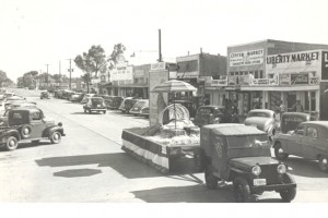 A parade runs through the main street of Downtown Gilbert in the 1940s.  Photo from the Gilbert Historical Society