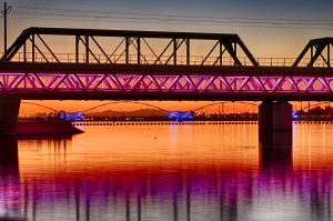 Tempe Town Lake light rail bridge connects the Phoenix-area METRO Light Rail with the downtown Tempe area. Behind, sits the Tempe Town Lake Pedestrian Bridge.  Photo from the City of Tempe.