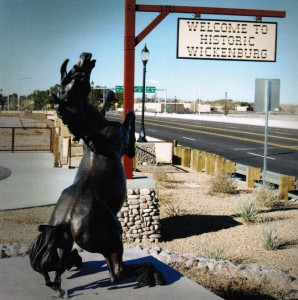 A sign and statue greet visitors on U.S. 60 entering Downtown Wickenburg.  Photo from the City of Wickenburg