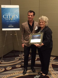 City of Goodyear Councilmember Wally Campbell receives the Digital Cities Survey Award at the National League of Cities Annual Congress of Cities in Nashville.